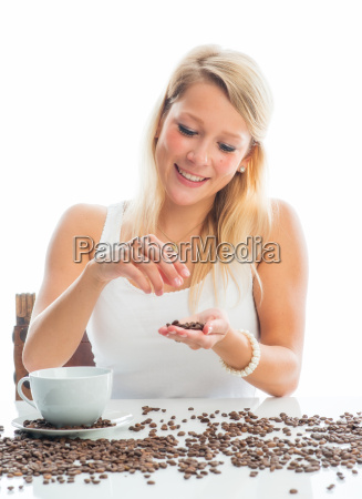 young woman with coffee beans