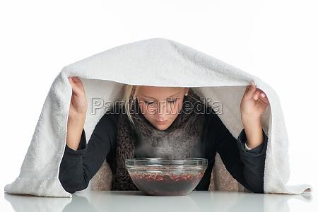sick woman inhales through aufgussschale