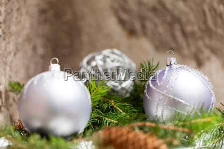silver baubles in green fir branches