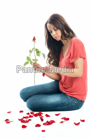 woman making love test on flower