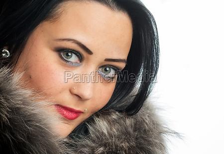 multiracial woman with fur collar