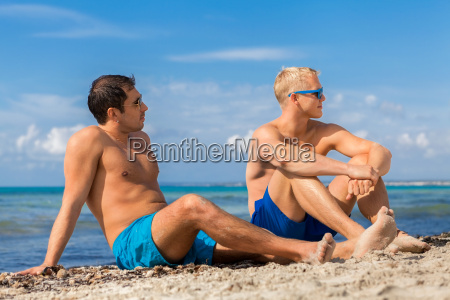 two young men friends relax on