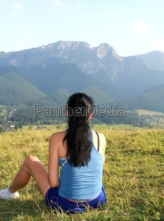 girl resting on the grass in