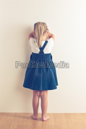 portrait of sad little girl standing