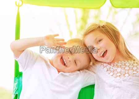 adorable children on swing