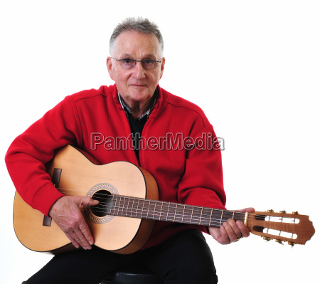 sprightly pensioner playing guitar
