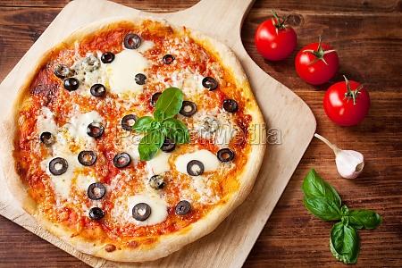 margherita pizza with olives mozzarella garlic