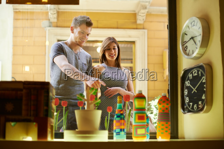 happy people with couple at window