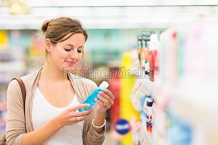 beautiful, young, woman, shopping, for, cosmetics - 11878021