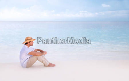 thoughtful man on the beach