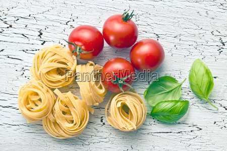 italian pasta tagliatelle tomatoes and basil