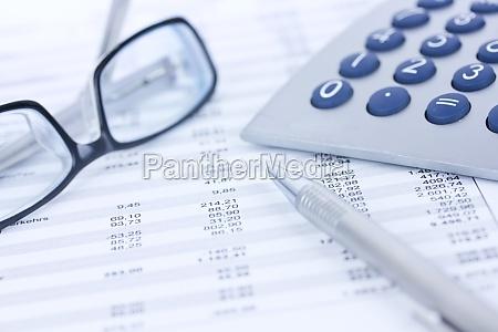 calculators and columns of figures
