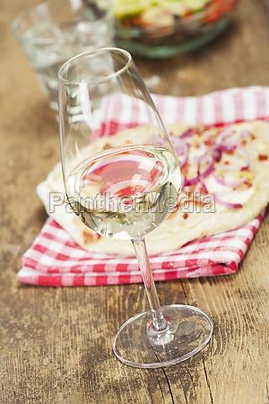 white wine and french tarte flambee