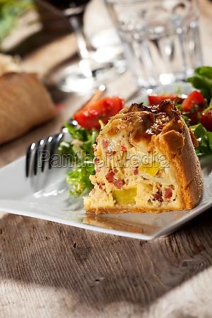 fresh quiche lorraine on a plate