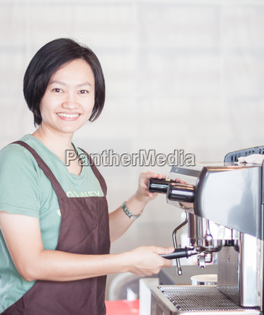 woman barista at work in coffee
