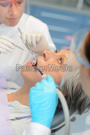 professional dentists checkup senior patient woman