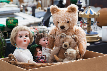 teddy bears and dolls at flea