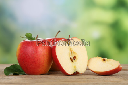 red apples in summer with text