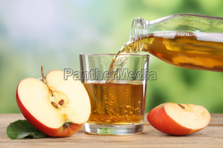 pour apple juice from red apple