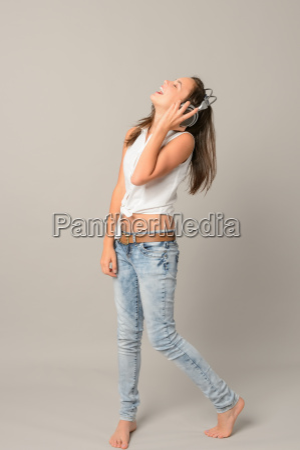 laughing teenage girl enjoy music from