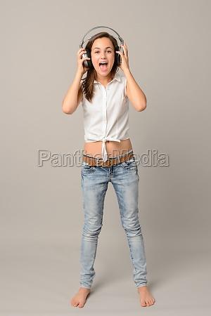 singing girl with headphones listen music