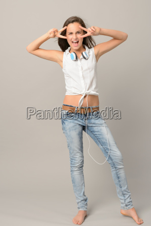singing teenager girl dancing full length