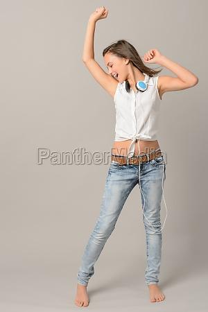 teenage girl dancing singing enjoy music