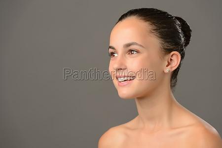 teenage girl bare shoulders skin cosmetics
