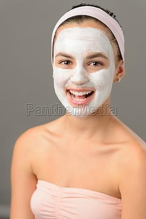 body care young woman facial mask