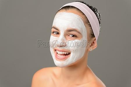 smiling teenage girl face mask bare