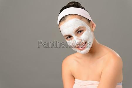 smiling teenage girl cosmetics mask skin