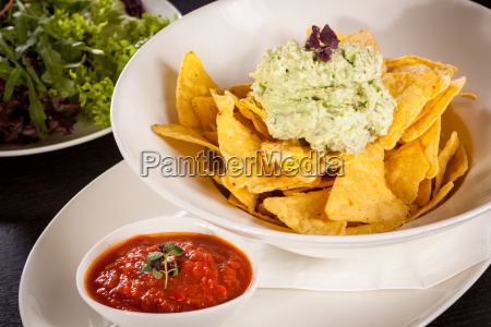 corn chips nachos with guacamole and