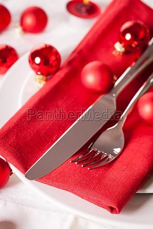 red napkin with christmas glass balls