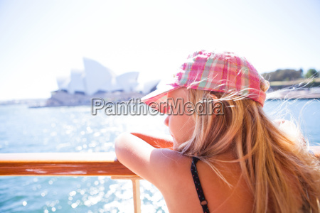 young, girl, looking, from, ferry, in - 11951973
