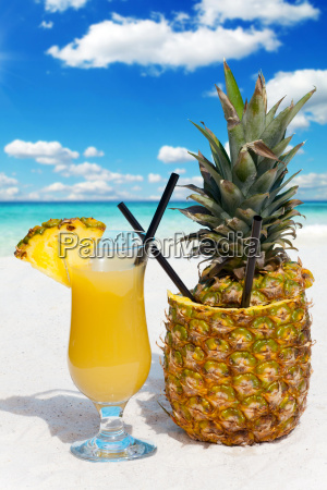 pineapple fruit and a cocktail