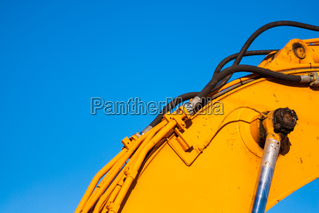 yellow machinery and hydraulics on blue