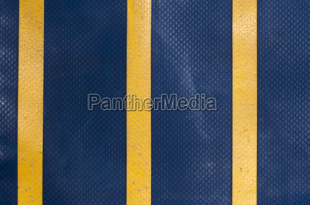 blue truck tarpaulin with yellow stripes
