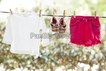 baby clothes drying in the backyard
