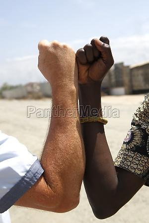 handshake between a caucasian and an