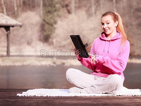 woman teenage girl in tracksuit using