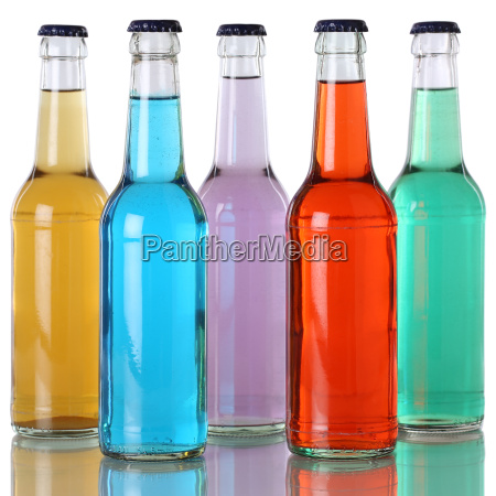 colorful drinks in bottles with reflection