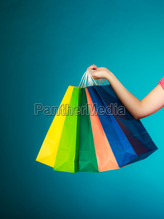 colorful shopping bags in female hand