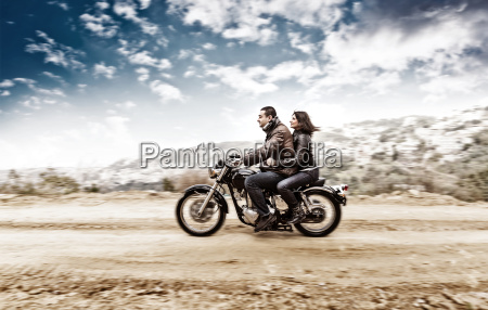 active couple on the motobike