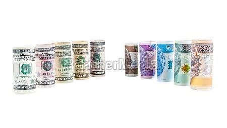 rolled dollar and polish zloty banknotes