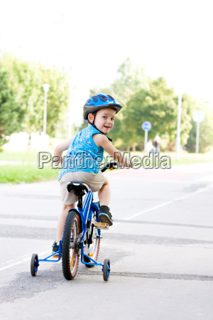 baby boy on bike with crash