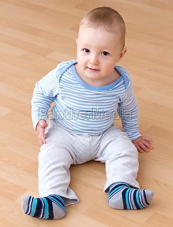 beautiful laughing baby boy sitting