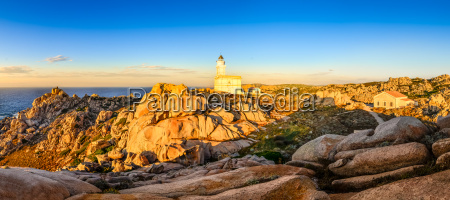rocky ocean coastline panorama with lighthouse