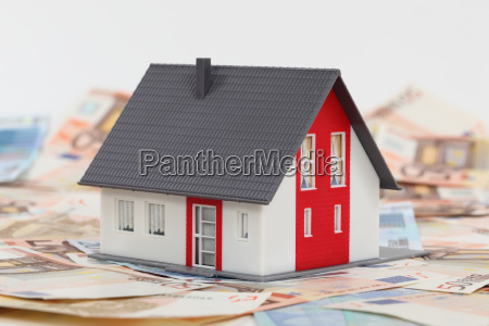 model house and euro banknotes