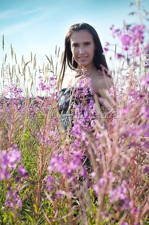 beautiful female on the flowers field