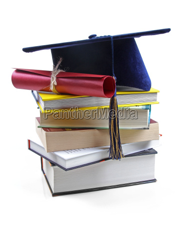 graduation hat and diploma on stack